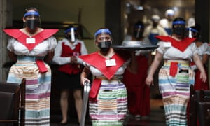 Staff at a restaurant in Mexico City have taken measures to avoid spreading the virus.