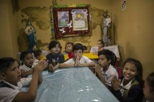 Children pray before lunch in Venezuela