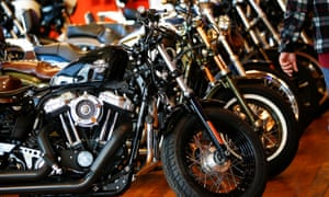 Harley-Davidson motorcycles are displayed for sale at a showroom in London on Friday. They could be significantly more expensive if China and the EU go ahead with planned retaliatory tariffs.