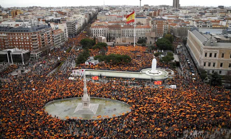 Demonstrators form a rally in Madrid's Colón square on Sunday.