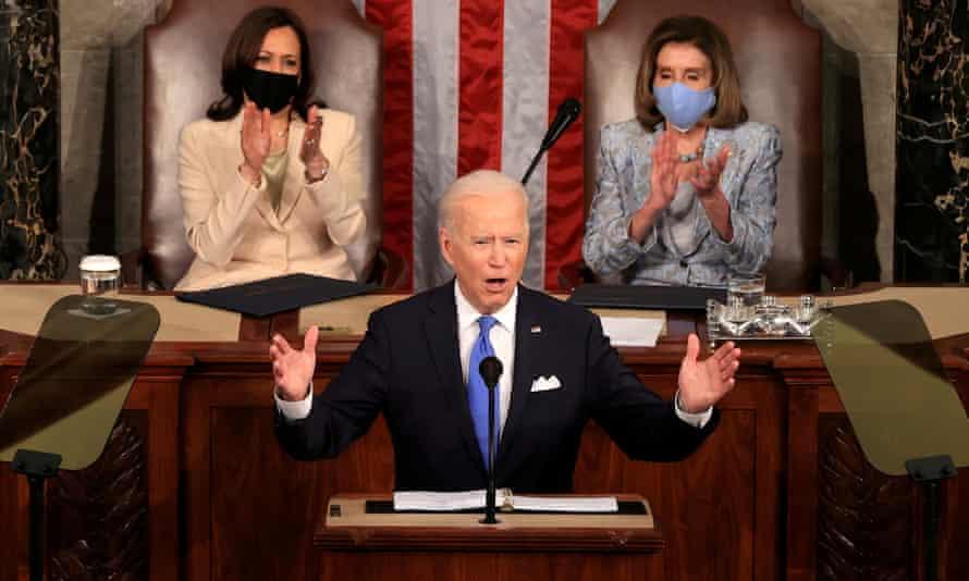 Joe Biden addresses a joint session of Congress as Vice-President Kamala Harris and Speaker of the House Nancy Pelosi applaud.
