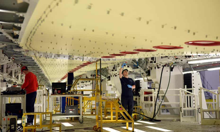 Workers construct a wing for an A350 aircraft at Airbus's Broughton plant in north Wales.
