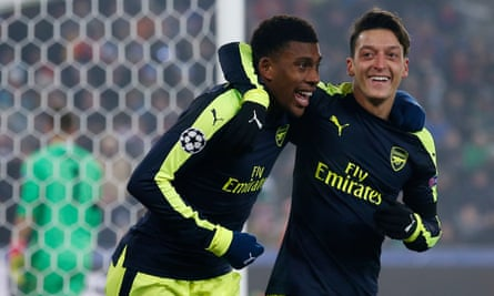 Alex Iwobi celebrates with Mesut Özil after scoring his first Champions League goal, in Arsenal's win at Basel