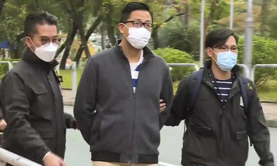 Lam Cheuk-ting (C) is arrested by police at his home in Hong Kong on Wednesday