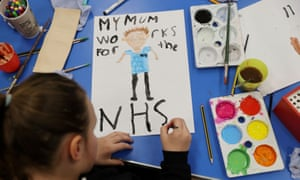 A primary school student paints a picture of her mother, who works for the NHS