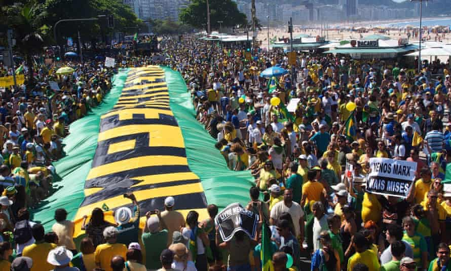 Demonstrators take part in a protest against the corruption scandal in Petrobras, growing economic hardship and in demand of the impeachment of Brazil's president, Dilma Rousseff.