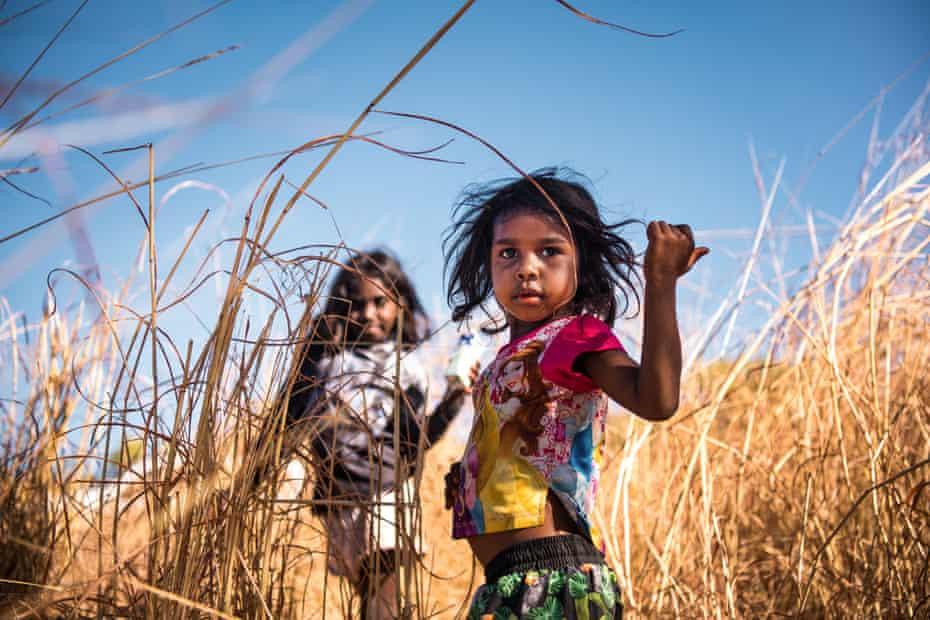 The joyful Anastacia Jumburra and Lizinta Jumburra in the grass.