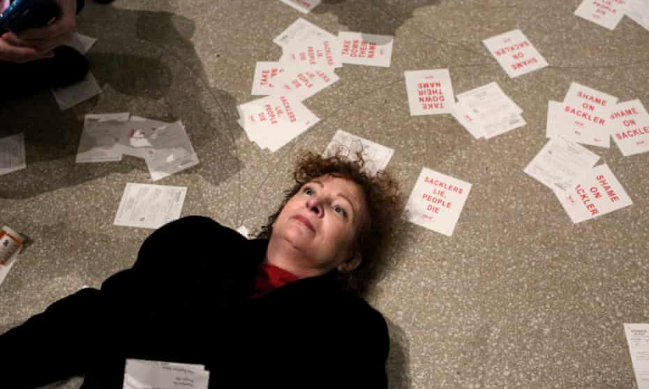 Nan Goldin stages a 'die-in' during the protest at the Guggenheim against funding by opioid manufacturers.