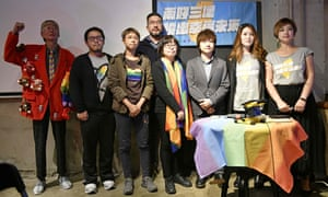 LGBT activists pose for photos during a press conference in Taipei after the referendum approving same-sex marriage failed to pass.