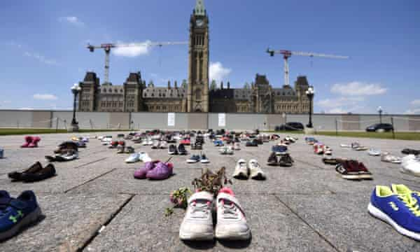 Dried flowers inside a pair of children's shoes at a monument on Parliament Hill in Ottawa for the 215 children whose remains were found in Kamloops.