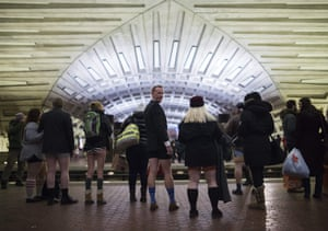 Participants in the No Pants Subway Ride DC, wait for a metro in Washington, DC.