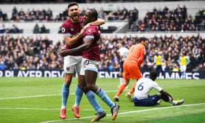 West Ham's Michail Antonio celebrates with his teammate Robert Snodgrass after scoring the only goal at the Tottenham Hotspur Stadium