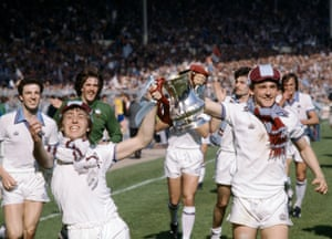 West Ham United's Geoff Pike and Paul Allen, right parade the FA Cup during the celebrations