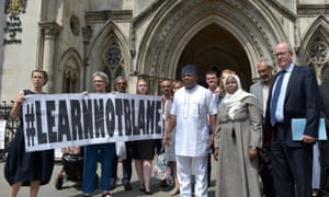 Hadiza Bawa-Garba (front right), her supporters and legal team stand outside the High Court in London.