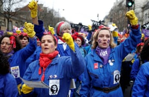 Women of General Confederation of Labour (CGT) dressed in work overalls demanding equality in Paris, France