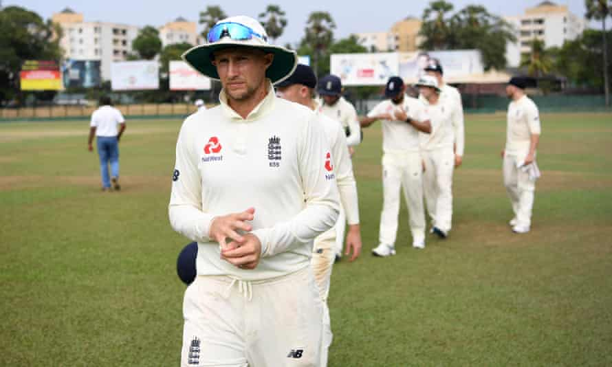 Joe Root leads his team from the field on 13 March after a tour match against SLC Board President's XI in Sri Lanka was abandoned due to the Covid-19 pandemic.