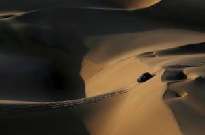 X-Raid's driver Orlando Terranova and co-driver Bernardo Graue traverse a sand dune