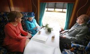 The Queen, Scotland's First Minister Nicola Sturgeon (L) and Prince Philip travelling on restored track.