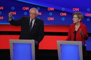 Senators Bernie Sanders and Elizabeth Warren speak during the Democratic debate in Detroit, Michigan.