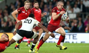 Mike Brown of England evades Peceli Yato of Fiji.