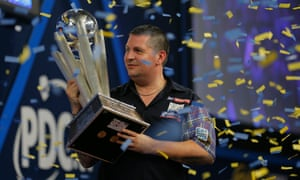 Gary Anderson lifts the Sid Waddell trophy after victory during the Gary Anderson v Adrian Lewis PDC World Darts Championship Final.