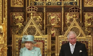 The Queen and Prince Charles on solid gold chairs.