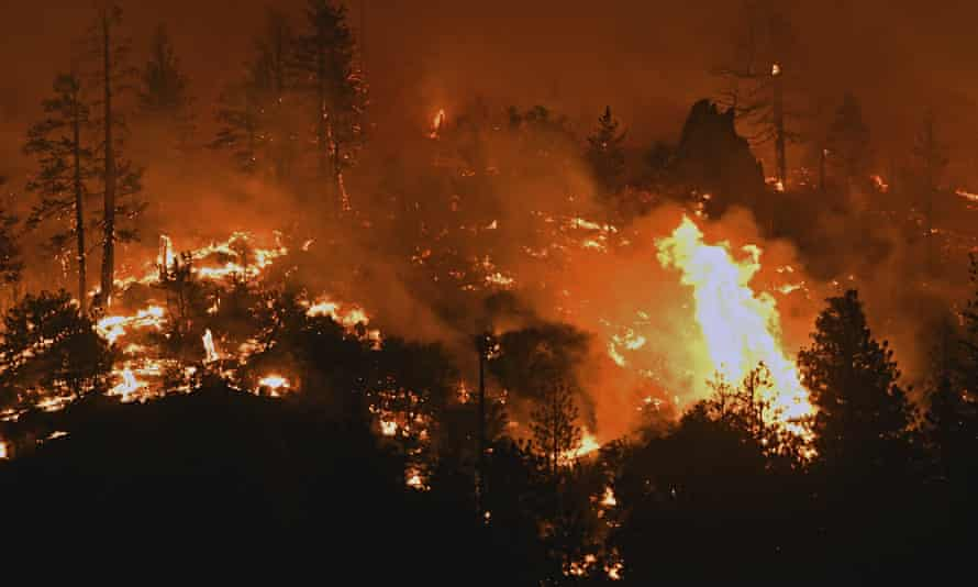 Flames from the Lava fire burn along a ridge near US Highway 97 and Big Springs Road north of Weed, California, on Monday.