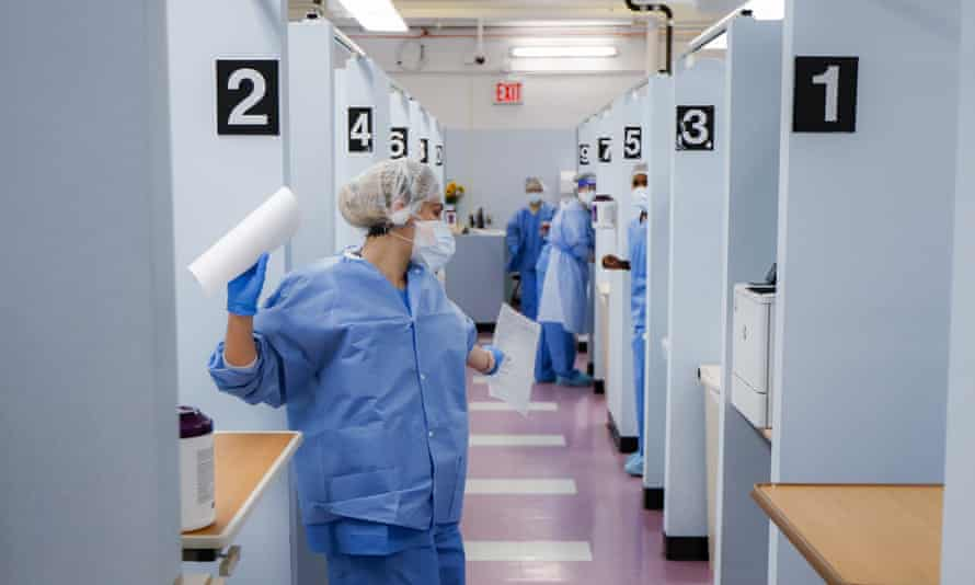 Medical personnel work in the Covid-19 medical screening annex at NYC Health + Hospitals Metropolitan, in New York on 27 May 2020.