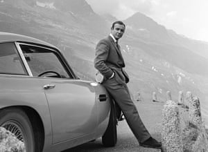 Connery with Bond's Aston Martin DB5 in Goldfinger, 1964