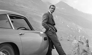 Sean Connery poses as James Bond next to his Aston Martin in Goldfinger.