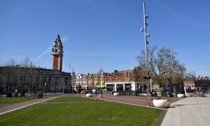 A man jogging through an empty Windrush Square in Brixton in London today.