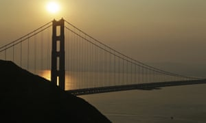 Smoke from wildfires obscures the Golden Gate Bridge. Outreach crews are helping the homeless who cannot shelter indoors.