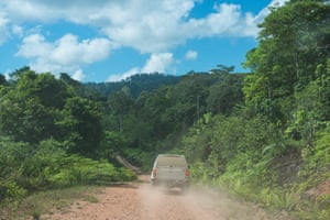 Off road vehicles make the journey into the remote forest