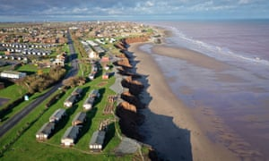 Holiday chalets abandoned due to coastal erosion wait to be demolished or taken by the sea in the village of Withernsea in the East Riding of Yorkshire