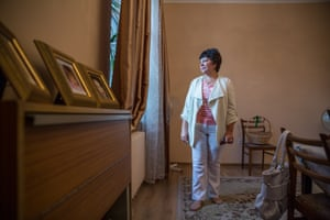Vera Voronina inside her condemned home that she has just newly redecorated. The pending demolition has caused her considerable stress and anxiety.