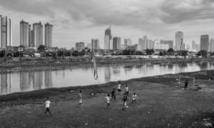 Children in densely populated Petamburan neighbourhood in central Jakarta use sedimented land on the bank of the Jakarta West Flood Canal to play football.