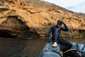 Videographer Stefan Andrew rests after a dive in the waters around Massillon Island, part of the Nuyts archipelago off the coast near Ceduna, in the Great Australian Bight
