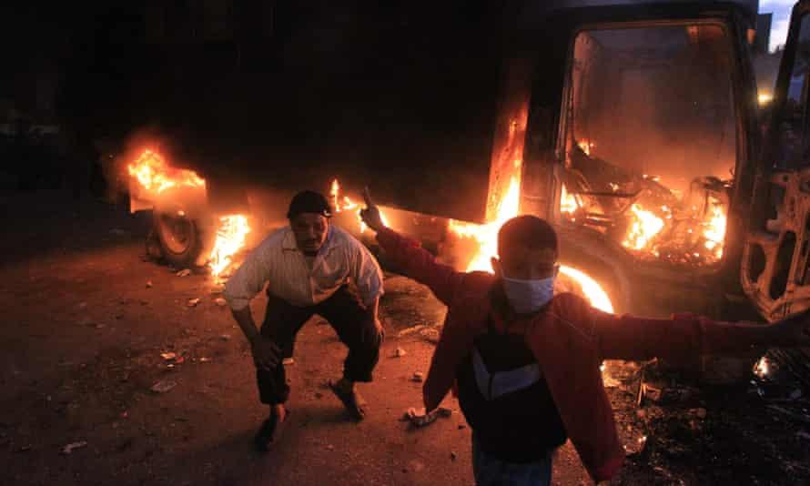 Egypt revolution - protesters celebrate as police car burns