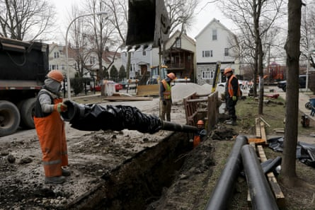 Department of water management crews install new water pipes Chicago, Illinois, in 2018.