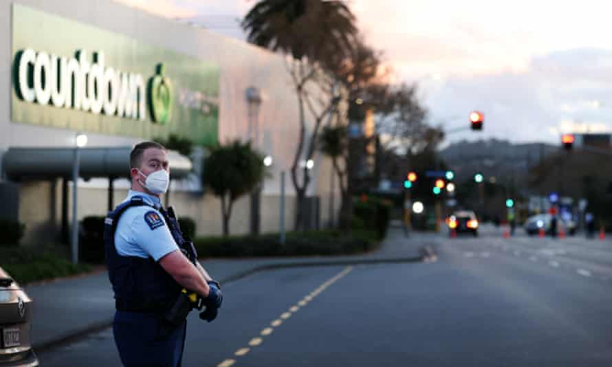 Police guard the area around Countdown LynnMall in auckland new zealand after a terrorist attack