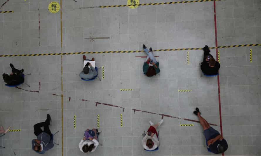 People wait for Covid vaccines in Santiago, Chile, on 16 February.