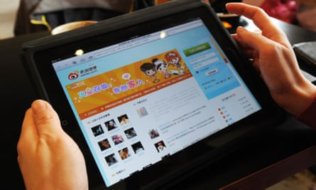 A woman views the Chinese social media website Weibo at a cafe in Beijing.