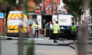 Police cordon in the Moss Side area of Manchester