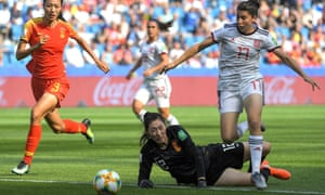 China's goalkeeper, Shimeng Peng, thwarts Spain's Lucía Garcia in the Group B match in Le Havre on Monday.