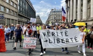 People attend a protest against Covid-19 restrictions, government's decision of vaccination obligation and Covid-19 health license application brought to some professions in order to combat coronavirus in Paris, France.
