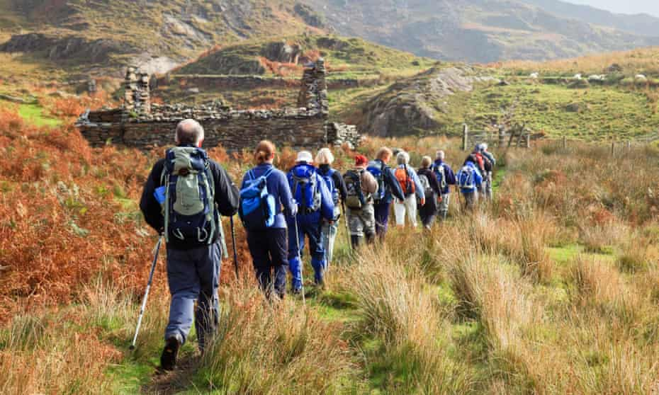 Ramblers walking in the Snowdonia National Park, at Nantgwynant, Gwynedd
