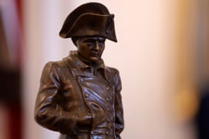 A bronze statue of Napoleon in a frock coat by Amédée Charron