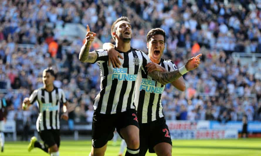 Joselu celebrates scoring Newcastle's opening goal against West Ham with Mikel Merino.
