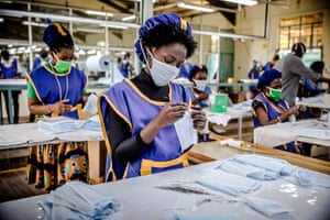 A worker produces face masks at the KICOTEC garment factory in Kitui, Kenya, which has begun 24 hours non-stop work to produce more than 30,000 masks per day