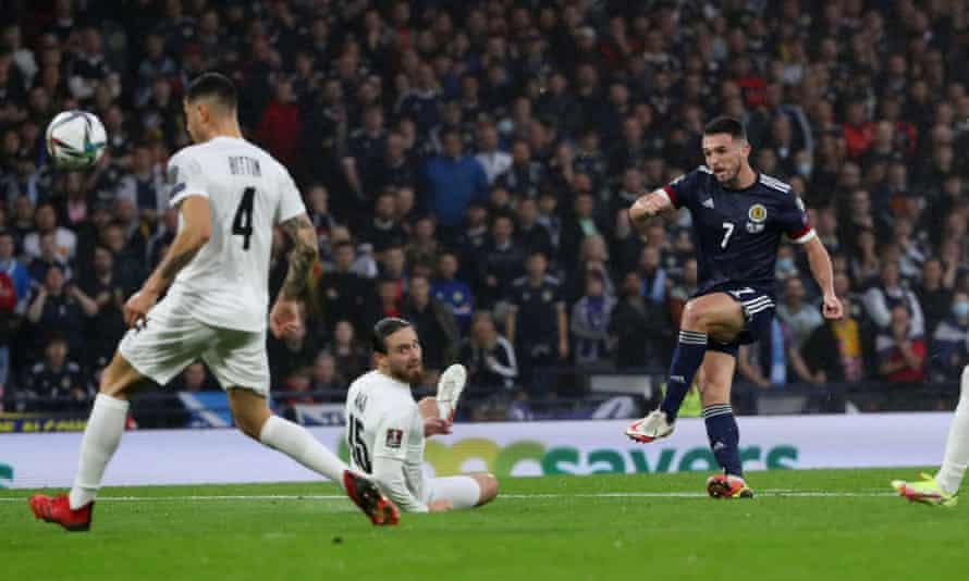 John McGinn picks out the top corner for Scotland's first.